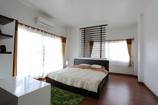 design of interior white bedroom in modern house